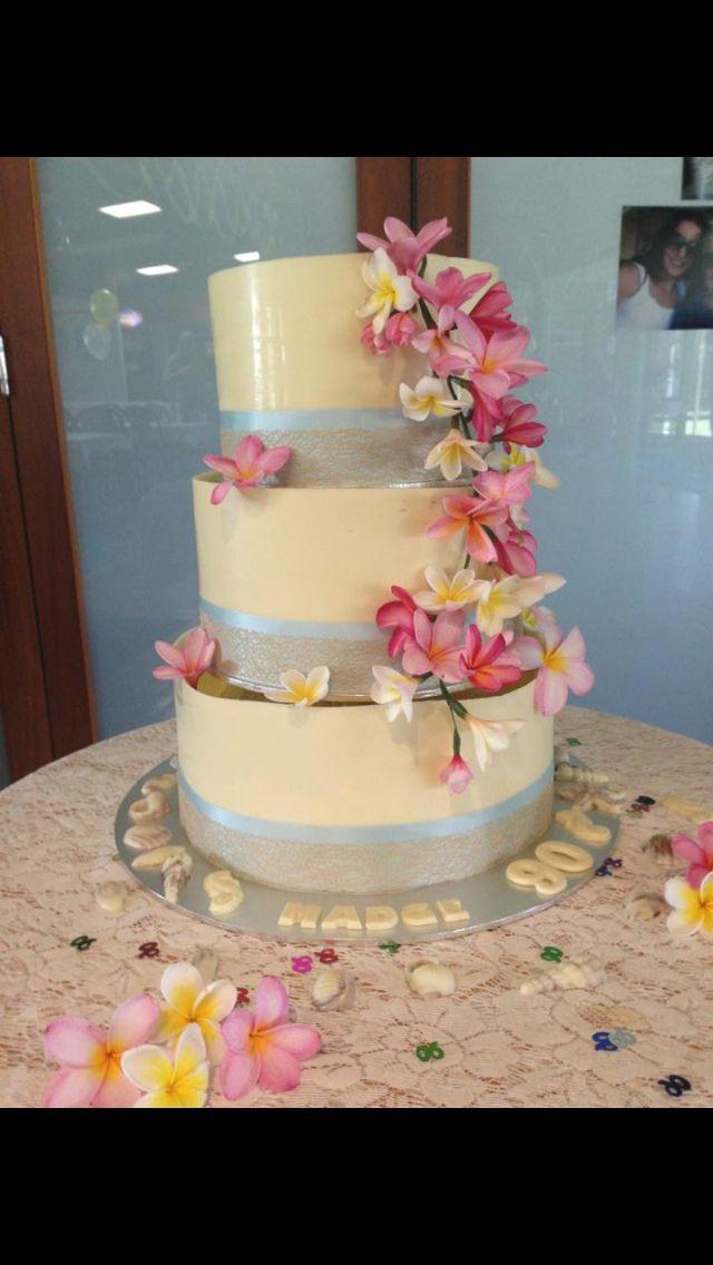 White chocolate beach theme cake with fresh frangipani's. Chocolate collars & chocolate shells.