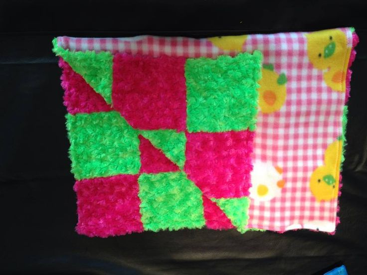 pink plaid with yellow and white ducks and green and pink rose on the back. small blanket for travel or in the stroller.