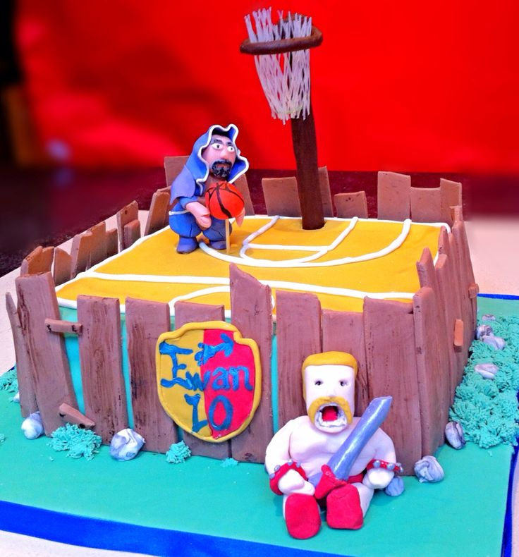 Clash of clans cake with chocolate basketball post and chocolate sugarpaste wood. Almond spelt low sugar cake with fresh raspberry buttercream icing.