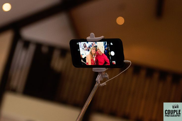 Selfie stick wedding favors for each table. Wedding photography at The Brooklodge Hotel by Couple Photography.