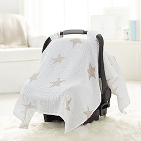 Over the river and through the woods, under little stars we go! Just snap this breathable muslin  canopy over your car seat, and baby is travel-ready.
