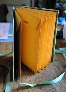 envelope book, this would be an easy, nice looking, way to organize things like receipts, money, and other important paper things.