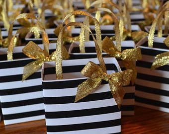 Black stripe favor bag with gold ribbon handles and bow