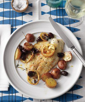 Roasted Tilapia, Potatoes, and Lemons|This month, we'll be featuring recipes from Real Simple's October story, Your Four-Week Dinner Plan. Today kicks off Week 1. In this incredibly delicious dish, kalamata olives lend a salty, briny flavor that perks up the mild white fish—and you'll need just one baking sheet to cook the whole meal.