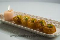 Balushahi-Crispy doughnut like mithai dipped in sugar syrup.