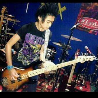 Alif playing guitar