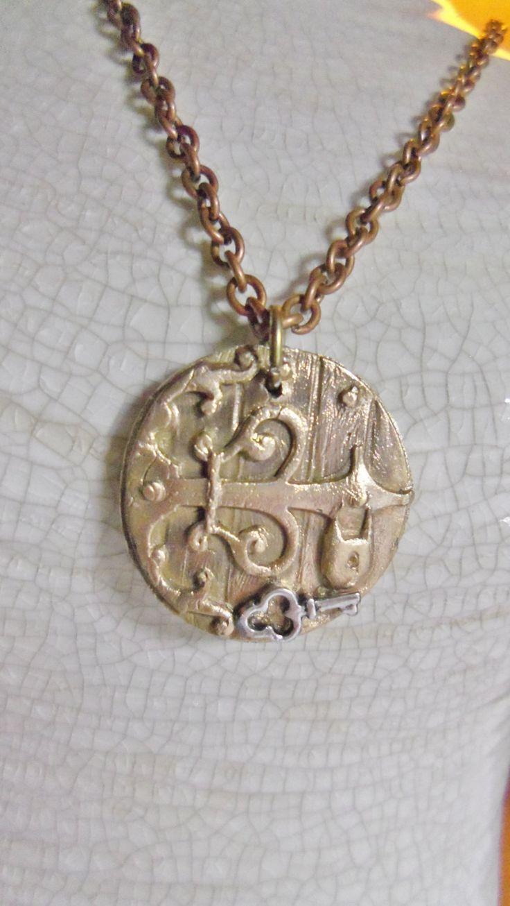 bronze medallion secret garden pendant by spiritracer on