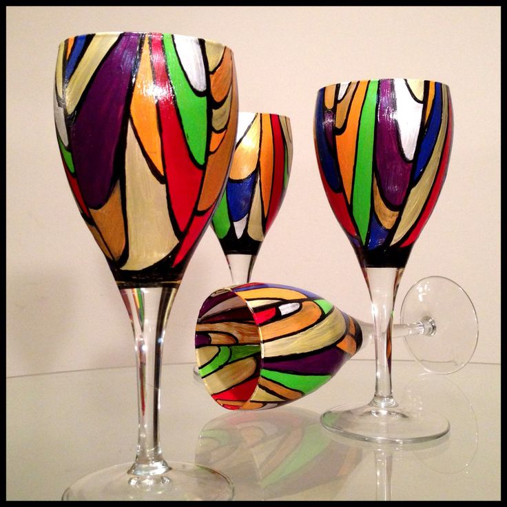 Hand painted wine glasses.  Abstract colorful stained glass design.  White wine glasses.. $150.00, via Etsy.