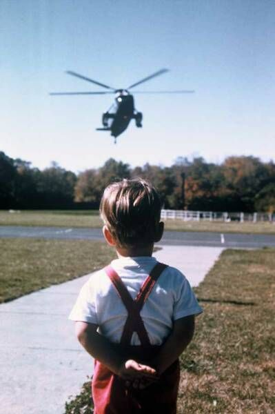 JFK Jr. waiting for his dad. So sad they were both killed by Evil Men. They were both set to change the USA for the Better....