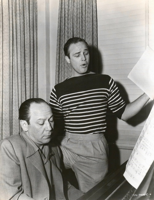 """Frank Loesser rehearsing for """"Guys And Dolls"""" with Marlon Brando. I think Loesser, coming where he does in the progression of Broadway composers, is directly smack dab in the middle way. He was old school """"Once in Love with Amy"""" Broadway, but also very innovative in his approach to lyrics and songs, a clear influence on Sondheim."""