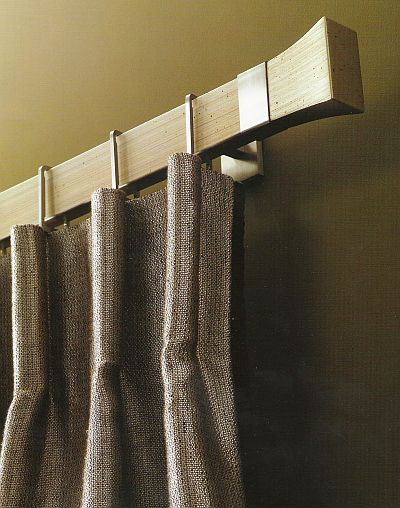 like the bold, clean look of this Conica style curtain rod in brushed nickel and antique silver