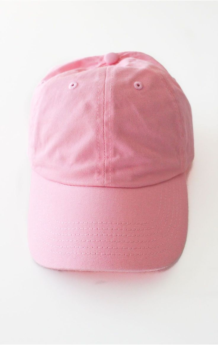 - Description Details: Six panel plain baseball cap in pink with adjustable back with tri-glide buckle. 100% Chino Twill. Imported Sizing: Adjustable, 2 1/4 x 4 1/2 Care: Machine wash cold
