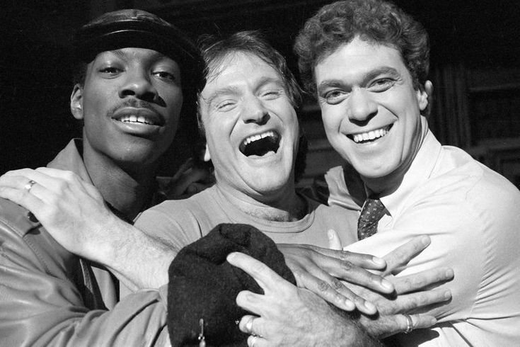 Robin Williams, center, takes time out from rehearsal at NBC's Saturday Night Live with cast members Eddie Murphy, left, and Joe Piscopo, Feb. 10, 1984.