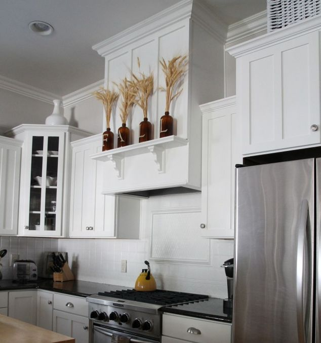 A homeowner hangs a board from her kitchen ceiling. A few steps later? This kitchen update is incredible!