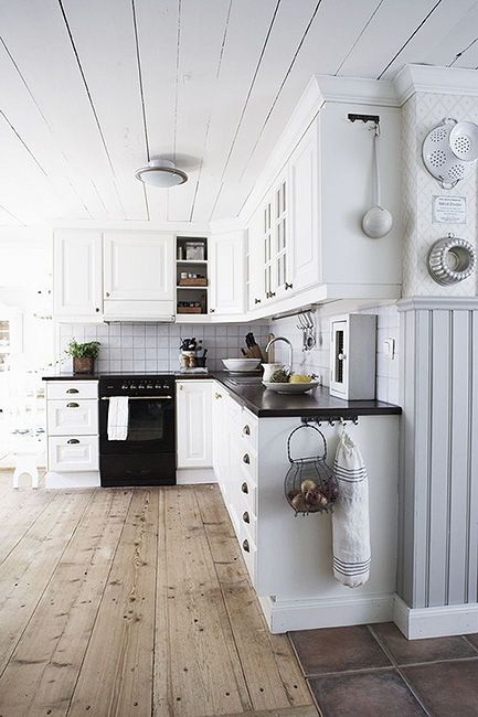 I have always hated having all the walls and ceilings of a home made of the same dark wood as the floor, i.e. dark, older cabins, but this is a fantastic way to separate the ceiling/walls from the floor. I like it. I also like the rustic floors opposed to shiny and polished ones.