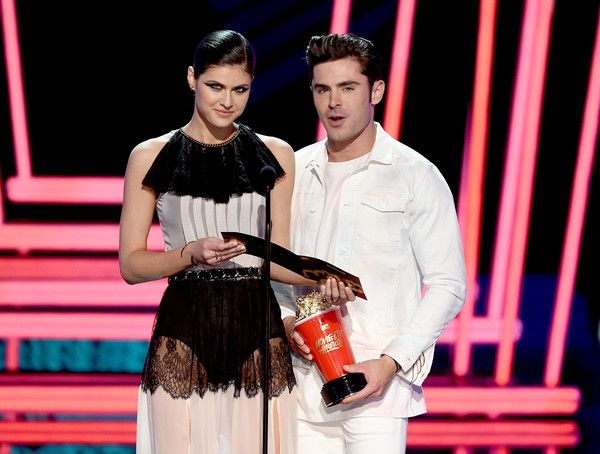 Zac Efron and Alexandra Daddario Photos Photos - Actors Alexandra Daddario (L) and Zac Efron speak onstage during the 2017 MTV Movie And TV Awards at The Shrine Auditorium on May 7, 2017 in Los Angeles, California. - 2017 MTV Movie And TV Awards - Show