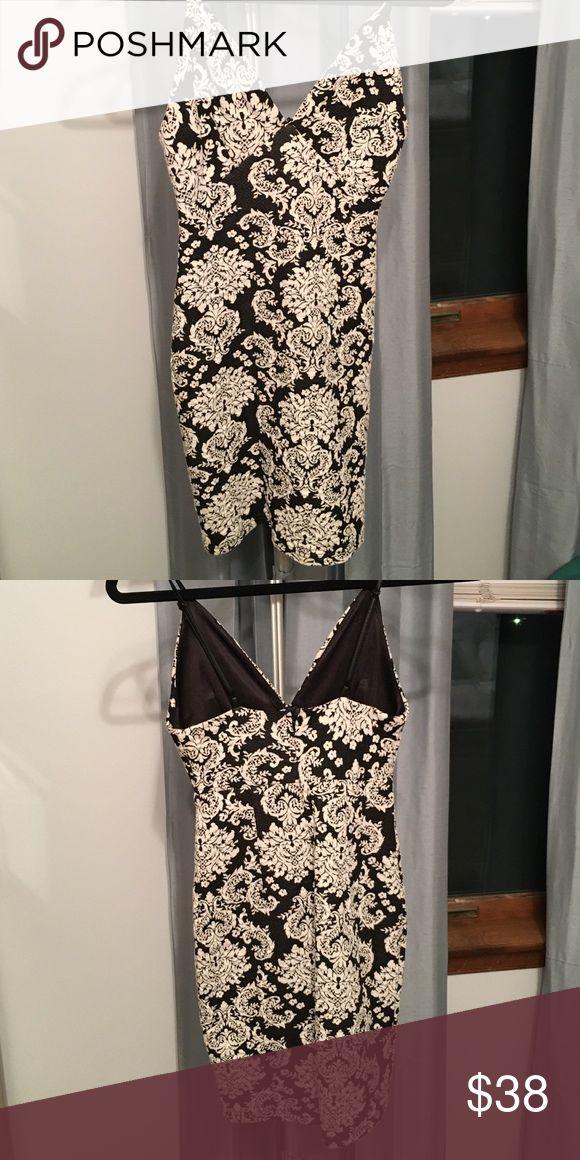 Black and white print mini dress Black and white print mini dress. Purchased at Nordstrom, only worn once. ASTR Dresses Mini