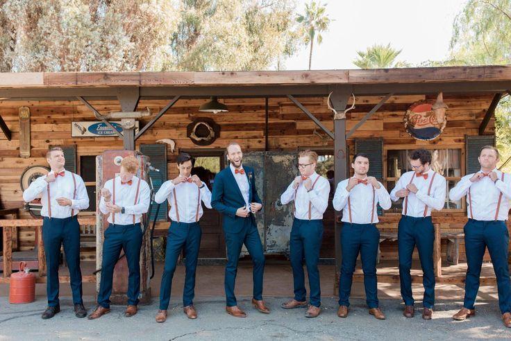 Burnt orange groom and groomsmen bowties, burnt orange suspenders.  Wedding Photography by www.leahvis.com