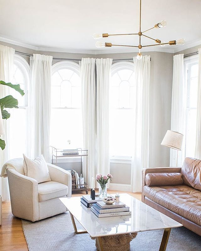 Neutral Living Room With A Leather Couch Wood And Marble Coffee Table White Chair Large W Leather Couches Living Room Curtains Living Room Living Room Paint