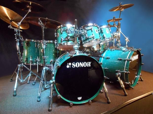"""Steve Smith's 1997 Sonor Designer Journey, Vital Information, Buddy's Buddies, $13,995.00 Steve Smith's 1997 Sonor Designer Journey, Vital Information, Buddy's Buddies This Sonor Designer Series drum set was owned and used by Steve Smith between 1997 and 2008. Smith originally acquired the set in preparation for an ill fated 1997 Journey tour that was canceled before it ever got started. He did use this set to record the video of Journey's """"When Yo..."""