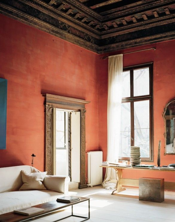 Earth-tone walls in sculptural and gorgeous Italian space