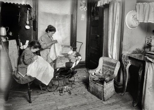"""January 1912. """"Tenement homework, NY, 309 W 146 St. Mrs. De Levo [?] and her 7-year-old daughter, Lorenza, embroider ladies' waists in their...kitchen-living room. Lorenza makes...flower stems. Her mother said, 'See how smart she is. I show her how and right away she makes them. She is so little because she's been sick so much.' She works after school. Father is out of a job. 'They pay too cheap for lace.' They make about $2 a week.""""  Lewis Wickes Hine for the National Child Labor Committee."""