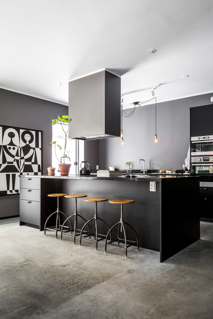 Wall art black and white by Alexander Girard at Girard studio. Lamps from Buster and Punch. Bar Stool from Broste Copenhagen.