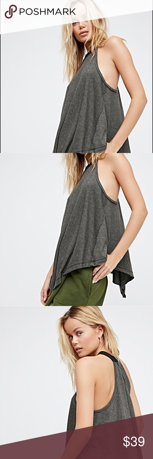 Twin Peeks Tank🍃 Relaxed racerback tank featuring an easy, swingy shape with an asymmetrical hem.  • Unfinished edges for a lived-in look • Contrast ribbed neckline detail   *By We The Free *50% Cotton, 50% Polyester *Machine Wash Cold *Import  Measurements for size: Extra Small *Bust: 36.0 = 91.4 *Length: 26.5 = 67.3. Army color Free People Tops Tank Tops