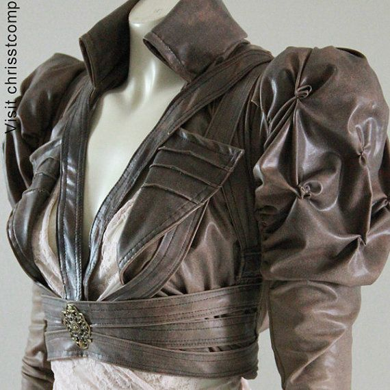 Bolero - Chrisst Bolero with detailed 2 piece puff sleeves, pin stiched lapels, high fold colour, harness strapping with v front, fastens under the arm with press studs.  Bolero made from stretch soft leatherette available in 3 colours tan, chocolate and Charcoal.