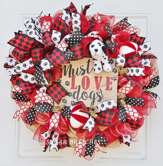 Must Love Dogs!!  This Red and Black Themed Dog Wreath is a perfect gift for that Dog Lover you know. Or Keep it for yourself.  A cute little puppy sits atop the sign and will greet your guests as they arrive to your home.  Put this wreath in you office or living space to admire every day.  Measures 26 x 26 x 8 and ready for immediate shipment.