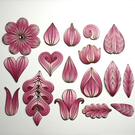 Both traditional and not so traditional petal forms and patterning by Lynne Ann Schwarzenberg, as seen on The Polymer Arts magazine's blog.  www.thepolymerarts.com