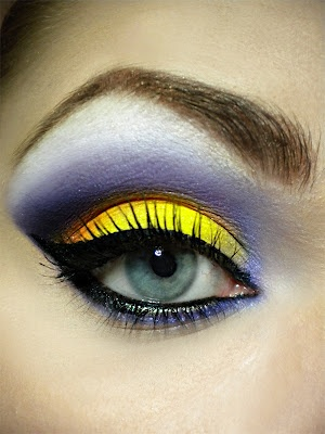 This reminds me of the tropical fish I saw snorkeling in Thailand...its beautiful but maybe only fish and makeup models can successfully sport it :P!
