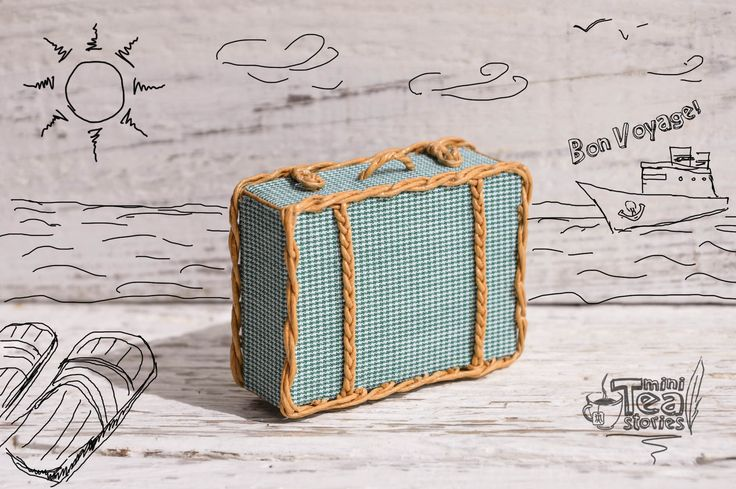 Miniature handmade suitcase with wicker elements made of carton, fabric and paper thread