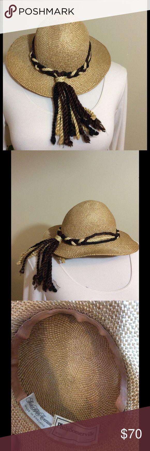 "PHILIP SOMERVILLE VINTAGE STRAW HAT TASSELS UK Make this yours for Spring/Summer! One of a kind vintage Philip Somerville for Saks Fifth Avenue Straw Wide Brim wedding, race, beach, day party hat. Made in England w/ tassels. Basically like new condition.   The Measurements: Head ""opening"" is 7"" across Hat Brim is 3"" Saks Fifth Avenue Accessories Hats"