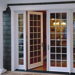 Replace dinning room bay window with French Doors Like the side lights. Prob wouldnt do mullions
