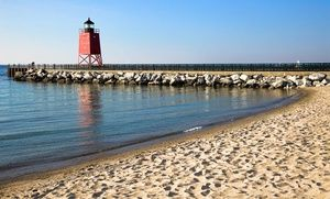 Groupon - 1-Night Stay with Unlimited DVD Rentals at Weathervane Terrace Inn in Charlevoix, MI in Charlevoix, MI. Groupon deal price: $89