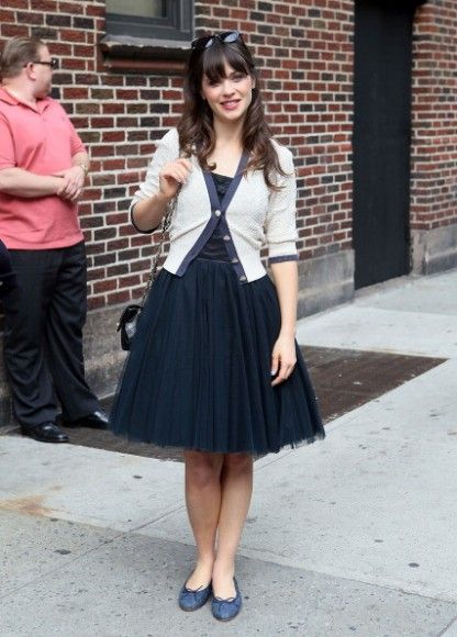 Zooey Deschanel's Navy tulle dress and white pointelle cardigan outside... love her style