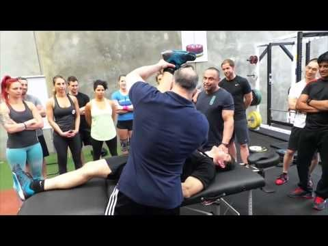 Coach Charles R. Poliquin Demonstrating Kinetic Chain Enhancement techni...