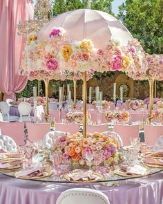 Love these umbrella centerpieces. Perfect for an afternoon or garden wedding or…