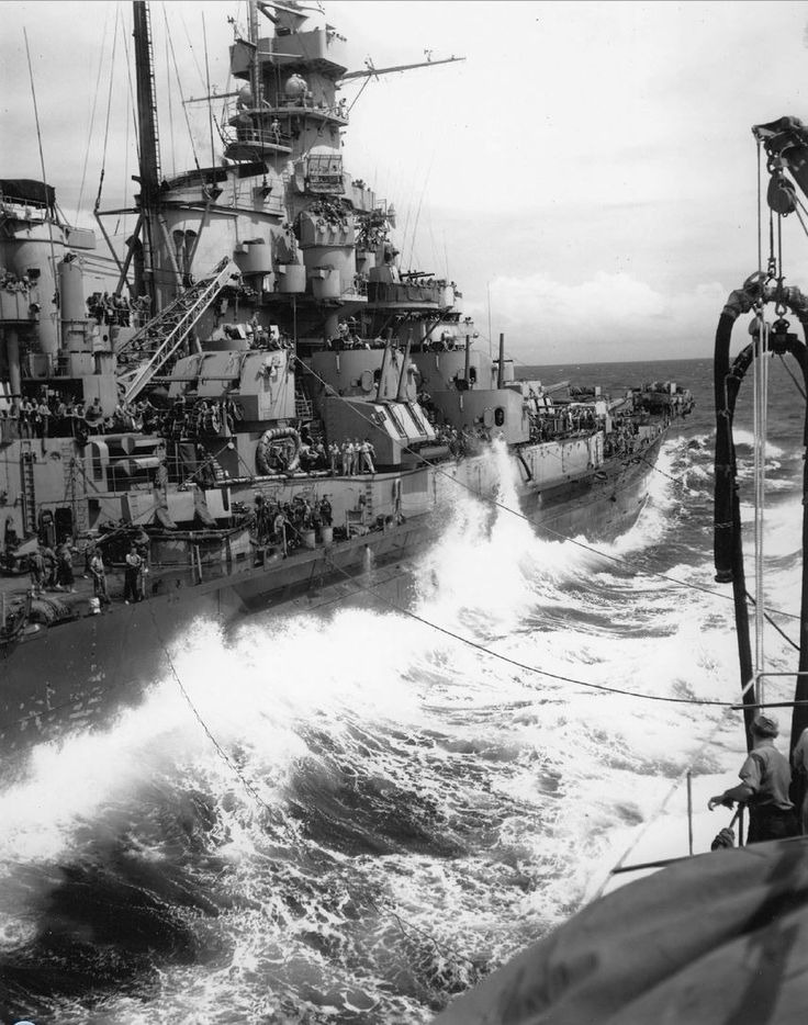 Massachusetts (BB-59) refueling from the T3-S2-A1 class Kaskaskia (AO-27) during a storm at sea, 17 October 1944. Note radar equipment Mk.8 atop Spot 2.