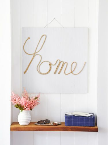Make your own wall art with some jute cord, hot glue, and a piece of plywood.