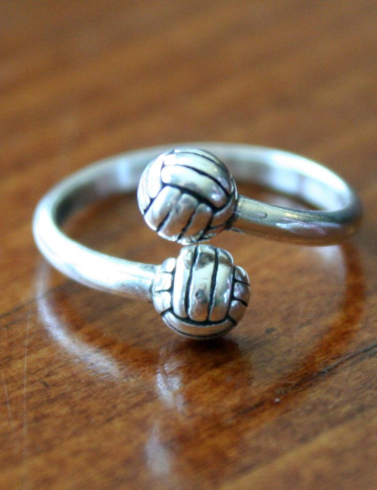 Volleyball players love wearing this Volleyball Adjustable Ring to express their love for their favorite sport. Volleyball jewelry make a great gift for yourself,  favorite volleyball player or volleyball coach.    This sterling silver volleyball ring features an adjustable band and is accented with two  volleyballs.  One size fits all.