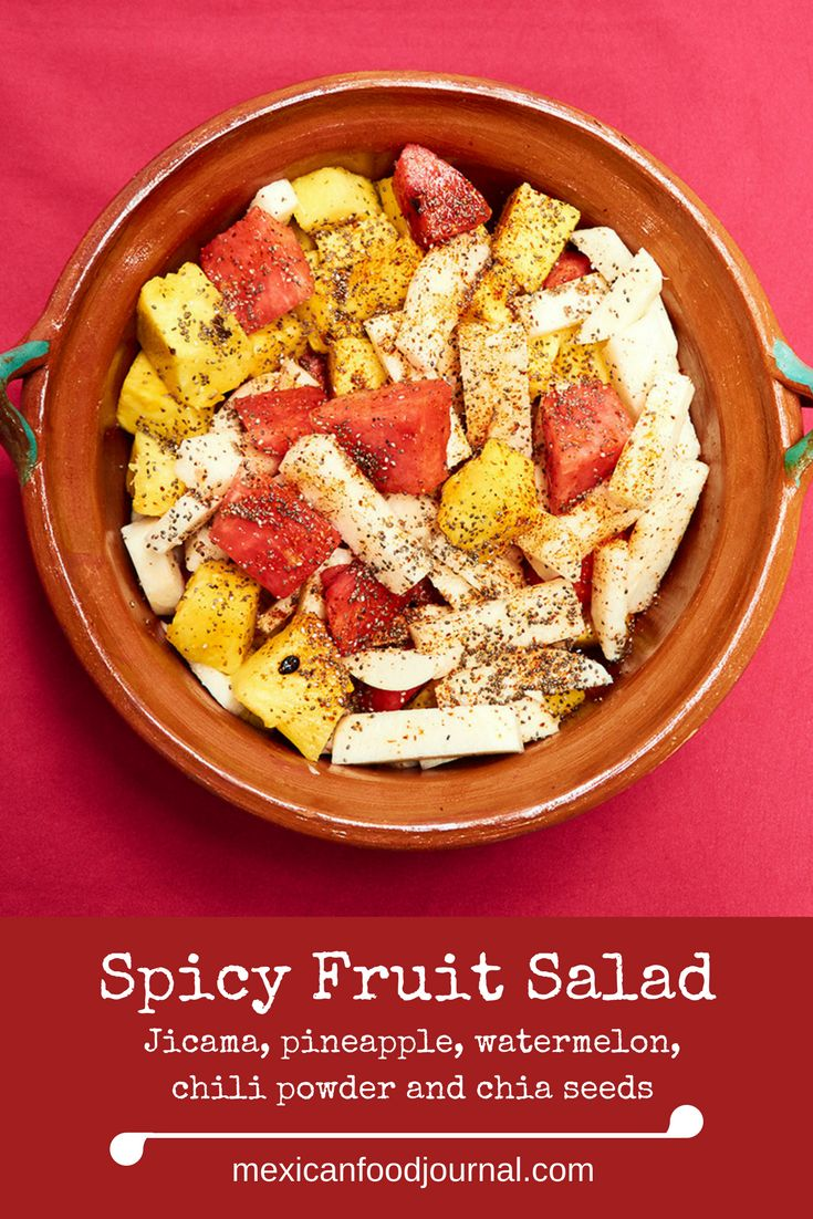 Versatile Mexican fruit salad, ensalada de fruta, prepared with jicama, pineapple, watermelon, Tájin chili powder and chia seeds. It's crunchy, tart, sweet, and spicy. Preparation time is only ten minutes.