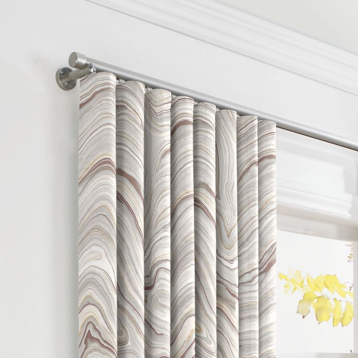 These marble geode curtains are making waves. And the ripplefold style creates a seamless, modern appearance to keep the ease of the pattern flowing.