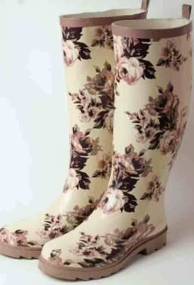 "Aubergine Rose Wellies    The once-utilitarian English boots have sauntered into a magnificent trend of florals. Our newest is a Victorian toile of plummish-mocha hue. No longer reserved for rain puddles and gardens, Wellingtons are spotted in boutiques and cafes with flouncy lace skirts. 6-10""."