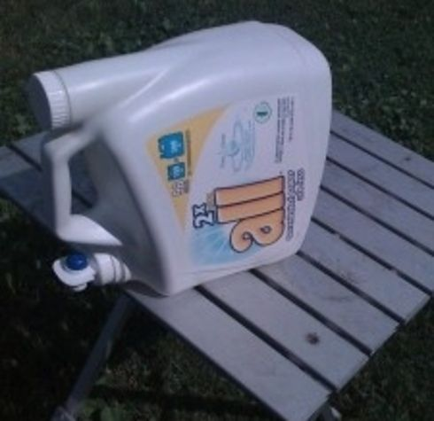 Use an empty laundry detergent dispenser as a hand-washing station.