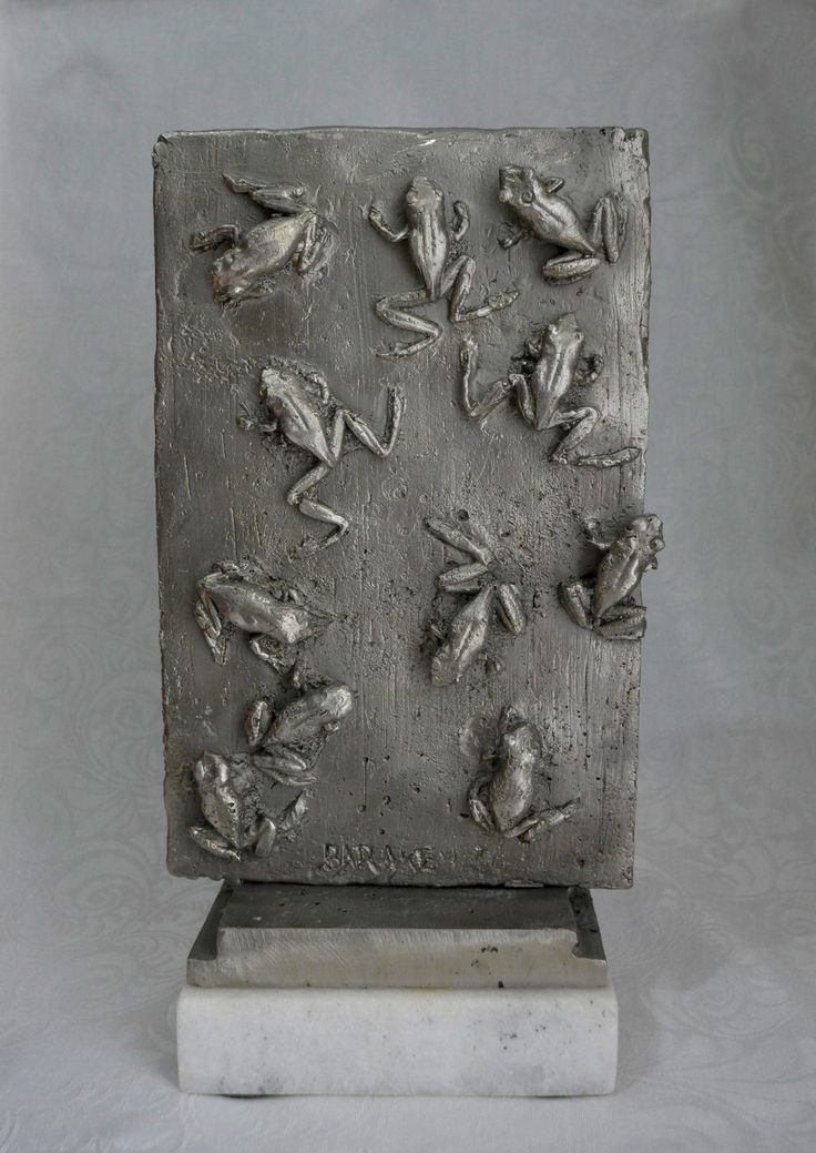 Eleven Toads. Cast Stainless Steel.