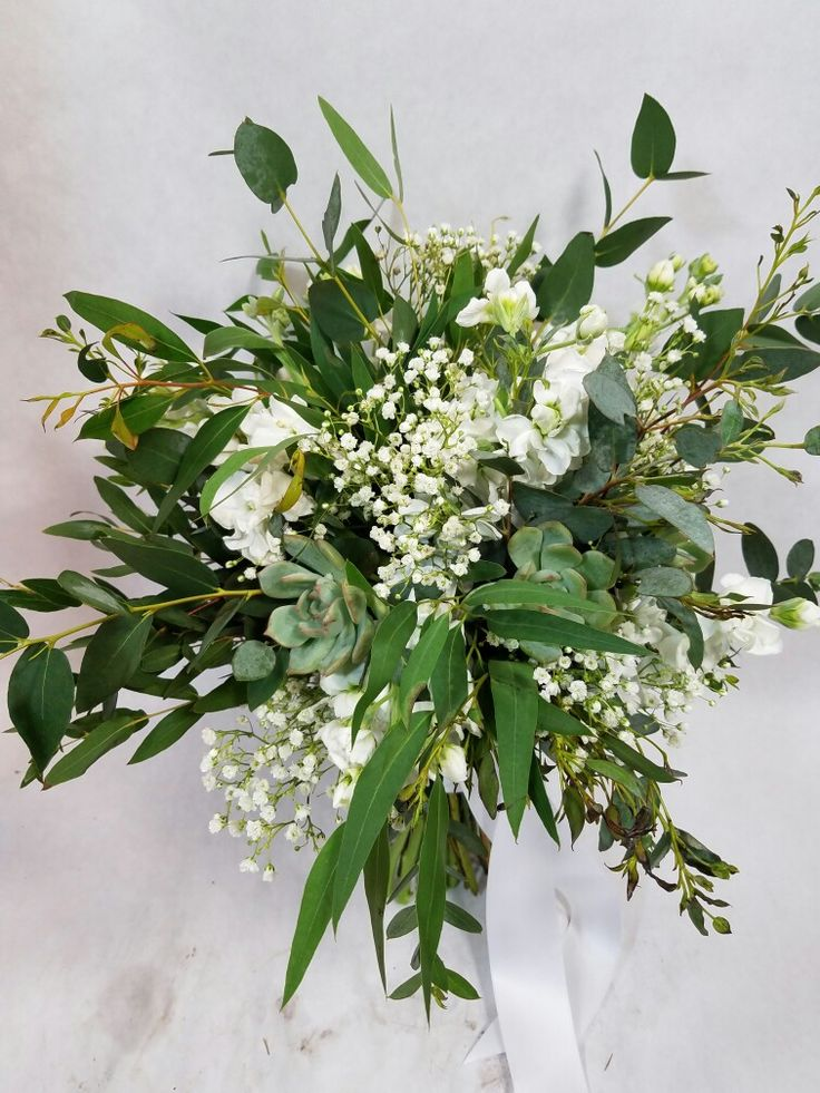 greenery bouquet with a touc of babies breath and white stock