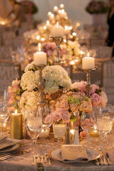 low flower centerpiece and high pillar candles