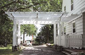 driveway pergola, this garden structure functions as both an open, overhead framework and a carport.Attached Pergola No. AP4a